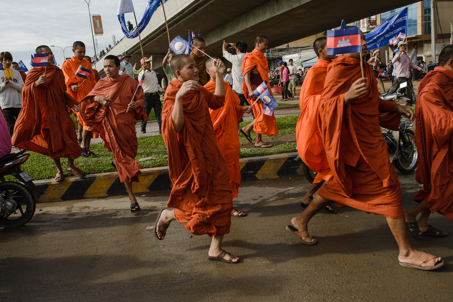 Young monks join an opposition party march from CNRP headquarter